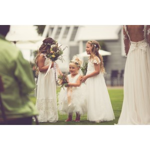 Beautiful flower girls with flower crowns and mini bouquets